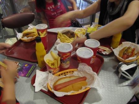Look at this table of fast food we ordered in Hong Kong Disneyland.  Hot dogs, fries, wings and soda...
