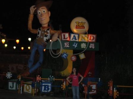 My sister proudly standing in front of Sheriff Woody