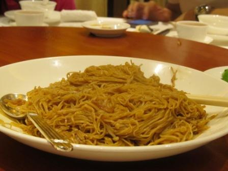 Stir-fried noodles with Japanese enoki mushrooms and soy sauce in Fook Lam Moon Restaurant