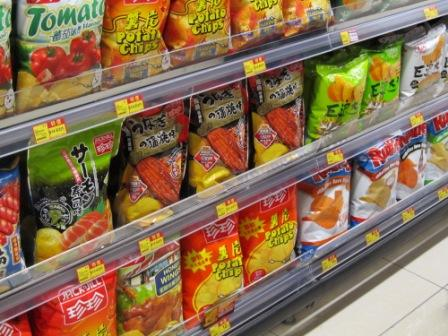 Here are some more flavors, such as tomato and sushi flavored chips.  On the bottom right corner, there are regular American brand chips.