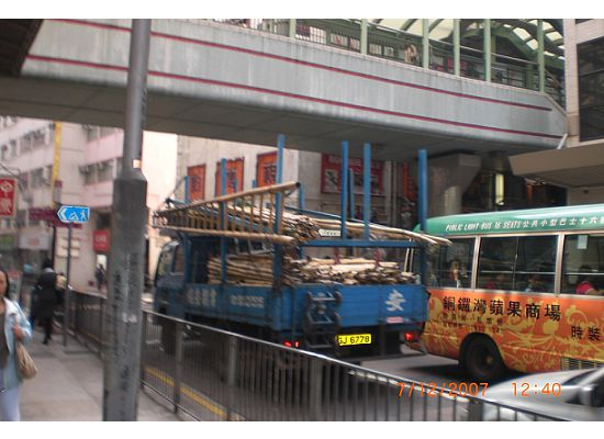 Outdoor Escalator on top of the busy traffic. You can either keep walking up the hill or down towards Central.