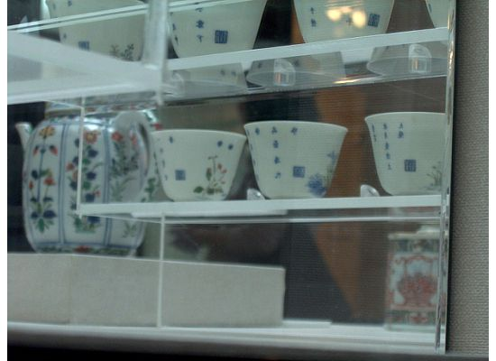 The closeup of the back of the Twelve Cups.  Can you see the stamp on each cup?  That's the name of the artist.