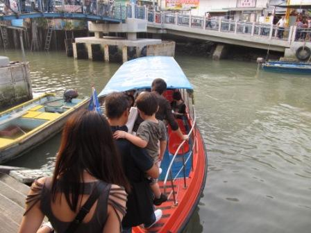Getting on our boat in Tai O Fishing Village