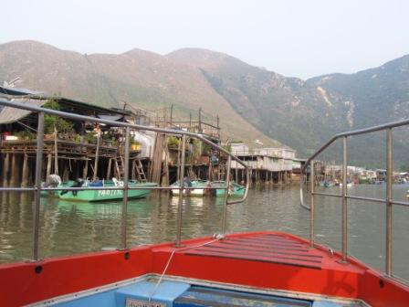 Can you see the man standing in the front porch of the house?  People live here usually rely on their boats to commute in Tai O Fishing Village