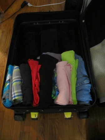 How to pack your luggage to save space?  Roll up your clothes!!!