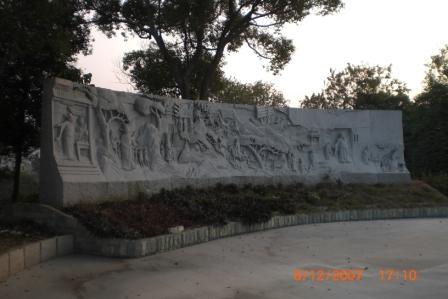 Stone carving at one of the corners in the Man Tin Cheung Memorial Park