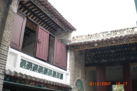 The deco on the outer wall of the building above the courtyard
