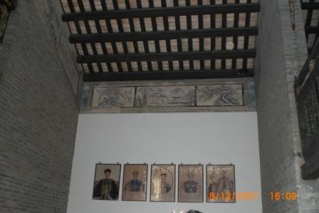 Chinese have the tradition to hang up pictures of their ancestors and worship them on a daily basis