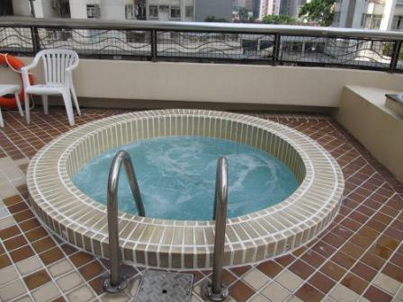 Jacuzzi next to the swimming pool in City Garden Hotel Hong Kong