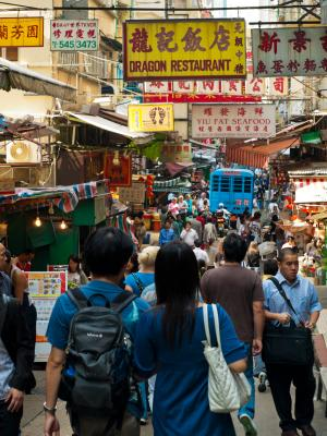 A typical Hong Kong wet market crowded with people from every walk of life and traffic....