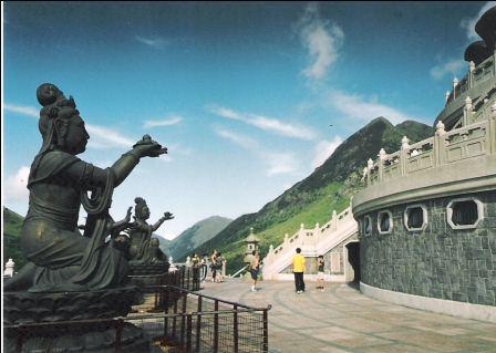 There are several statues surrounding the Hong Kong Giant Buddha. Each of them has a different gesture and different stuff in their hands.