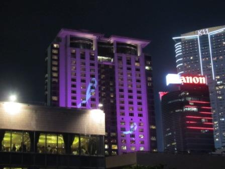 Just before the Symphony of Lights starts, lights shines on some of the participating buildings.  This is the Peninsula Hotel featuring the awareness of breast cancer.