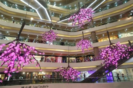 The peach blossom, one of the most popular Chinese New Year flowers, hanging upside down in the Times Square, Causeway Bay, Hong Kong