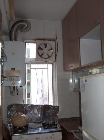 The kitchen did not have enough room for 2 people to work side by side.